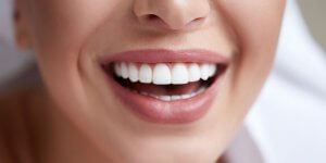 closeup of woman's mouth, smiling